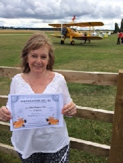 Teresa shows off her certificate